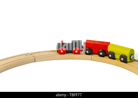 Colorful wooden toy train goes on rails. Isolated on white background. Perfect template, concept for promotion, ad, sale, poster, web-banner, article. - Stock Photo