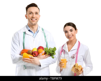 Portrait of nutritionists on white background - Stock Photo