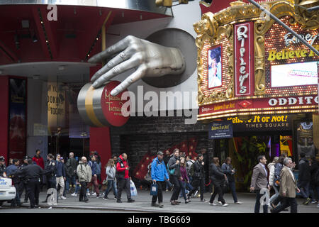 People stream by Madame Tussaud's New York Wax Museum of Celebrities, a popular tourist attraction on 42nd Street in Manhattan. - Stock Photo