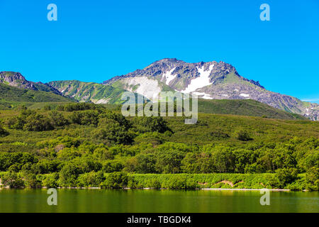Kurile lake, forest and the hills South Kamchatka Nature Park, Russia - Stock Photo