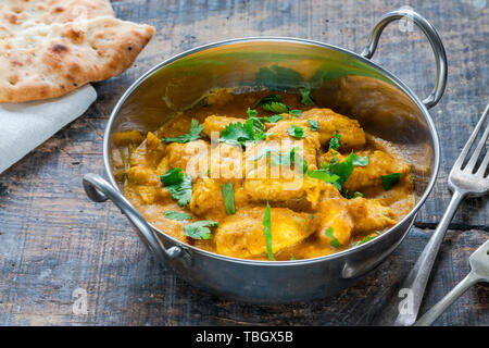 Chicken korma curry with naan bread - high angle view - Stock Photo