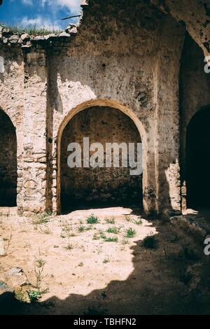 An old destroyed stone cave located in Armenia - Stock Photo