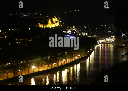 in georgia tbilisi the view of the city   near the river and old architecture in the night blur and noise - Stock Photo