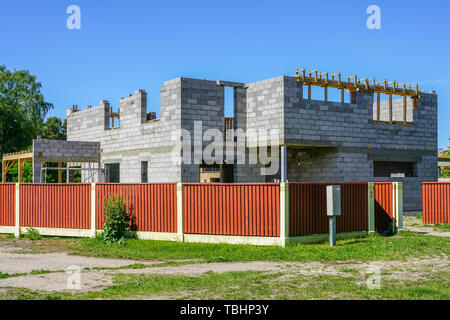 Concrete foundation and wall construction of a new house, view of construction site in preparation process - Stock Photo