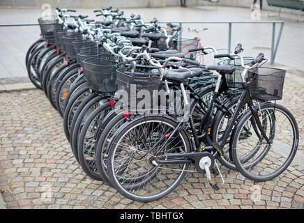 Bicycles in a row in Södra Blasieholmshamnen, Stockholm, Sweden, during a rainy day Stock Photo