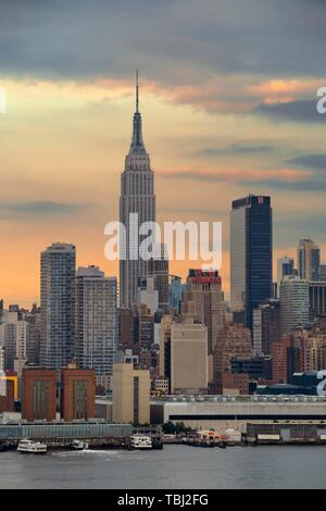 NEW YORK CITY - JUL 4: Empire State Building with skyscrapers on July 4, 2015 in Manhattan, New York City. With population of 8.4M, it is the most populous city in the United States. - Stock Photo