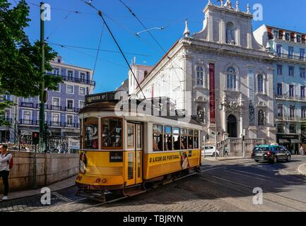 Lisbon, Portugal. 13th May, 2019. 13.05.2019, Lisbon, capital of Portugal on the Iberian Peninsula in the spring of 2019. A typical tram in front of the Igreja Nossa Senhora do Loreto ('Church of Our Lady of Loreto'), also called Igreja dos Italianos. It is a Roman Catholic parish church in the center of Lisbon. It is located on the north side of Largo do Chiado at the Praça Luís de Camões. | usage worldwide Credit: dpa/Alamy Live News - Stock Photo