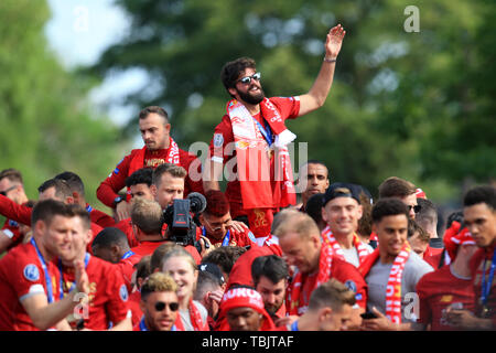 Liverpool, Merseyside. 2nd June, 2019. Liverpool FC celebration parade after their Champions League final win over Tottenham Hotspur in Madrid on 1st June; Liverpool goalkeeper Alisson Becker waves to the crowds lining the route Credit: Action Plus Sports/Alamy Live News - Stock Photo