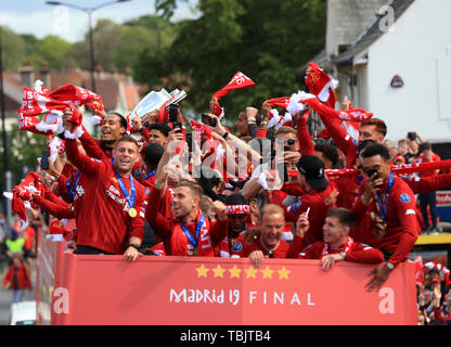 Liverpool, Merseyside. 2nd June, 2019. Liverpool FC celebration parade after their Champions League final win over Tottenham Hotspur in Madrid on 1st June; the Liverpool players wave scarves above their heads Credit: Action Plus Sports/Alamy Live News - Stock Photo