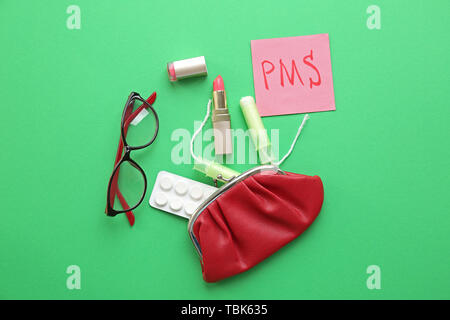 Composition with bag, tampons, pills, glasses and paper with text PMS on color background - Stock Photo