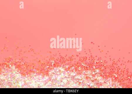 Shiny iridescent glitters on color background - Stock Photo
