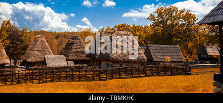 Traditional Romanian village with old house straw roofing - Stock Photo