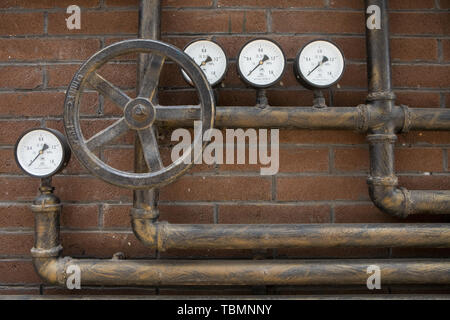 Closeup of a pressure meter on a machine - Stock Photo