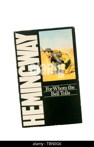 Paperback copy of For Whom the Bell Tolls by Ernest hemingway.  Hemingway's novel of the Spanish Civil War, first published in 1941. - Stock Photo