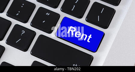 Text Rent on blue computer keypad button - Stock Photo