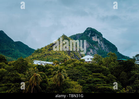 Villas sitting in mountains on Mahe Island, Seychelles - Stock Photo