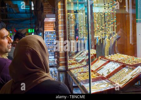 TEHRAN, IRAN - MAY 22, 2017:  People looking at jewelry at Grand Bazaar in Tehran, Iran - Stock Photo