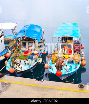 Typical Cyprus fishing boats in Limassol harbor - Stock Photo