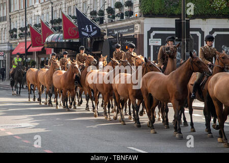 The Royal Household Cavalry transfer unmounted horses to stables along Buckingham Palace Road in Central London - Stock Photo