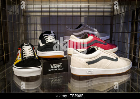 SHEFFIELD, UK - 2ND JUNE 2019: Mens Vans trainers on display for sale in a store in the UK - Stock Photo