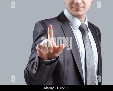 close up. businessman presses his finger on the virtual point.isolated on grey background. - Stock Photo
