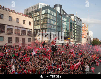 Liverpool, Merseyside. 2nd June, 2019. Liverpool FC celebration parade after their Champions League final win over Tottenham Hotspur in Madrid on 1st June; thousands of fans line the route along the Strand as the team bus passes Credit: Action Plus Sports/Alamy Live News - Stock Photo