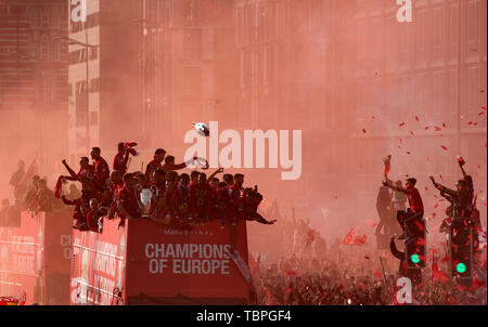 Liverpool, Merseyside. 2nd June, 2019. Liverpool FC celebration parade after their Champions League final win over Tottenham Hotspur in Madrid on 1st June; an inflatable trophy floats above the team bus as it passes along the Strand Credit: Action Plus Sports/Alamy Live News - Stock Photo