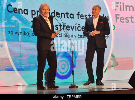 Zlin, Czech Republic. 31st May, 2019. Czech singer Karel Gott, left, takes the 'Golden Slipper' award for exceptional interpretation of songs in Czech films, within the 59th Zlin Film Festival - International film festival for children and youth, in Zlin, Czech republic, on May 31, 2019. On the right side is seen moderator Jan Censky. Credit: Dalibor Gluck/CTK Photo/Alamy Live News - Stock Photo