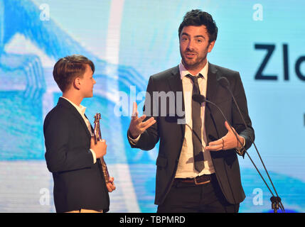 Zlin, Czech Republic. 31st May, 2019. Film director Steven Wouterlood, right, and child actor Sonny Coops van Utteren take the Golden Slipper award for the 'My Extraordinary Summer with Tess' - best feature film for kids, within the 59th Zlin Film Festival - International film festival for children and youth, in Zlin, Czech republic, on May 31, 2019. Credit: Dalibor Gluck/CTK Photo/Alamy Live News - Stock Photo