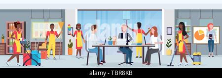 janitors team african amerian cleaners in uniform working together with professional equipment cleaning service concept creative co-working center - Stock Photo