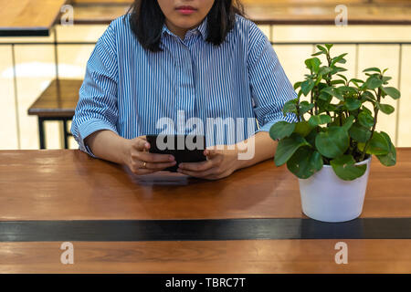 Young woman reading ebook on the tablet - Stock Photo