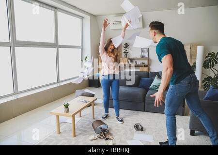 Young quarrelling couple at home - Stock Photo