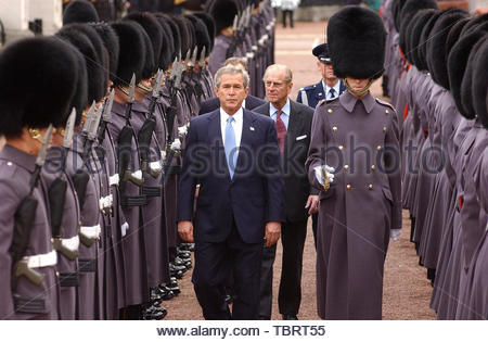 File photo dated 19/11/03 of the then US President, George Bush, walking ahead of the Duke of Edinburgh during an inspection of the Guard of Honour at the ceremonial welcome at Buckingham Palace on the first day of his state visit to the UK. Donald Trump???s state visit to the UK is only the third by a US president. - Stock Photo