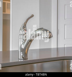 Square Close up of the shiny sink and faucet inside the kitchen of a new house