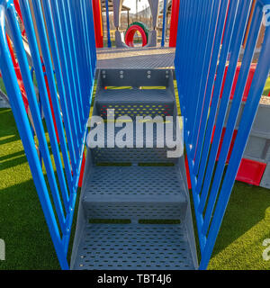Square frame Stairs going up a slide overlooking mountain and bright sky on a sunny day - Stock Photo