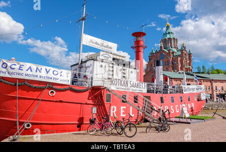 View to historic red lightship Relandersgrund now restaurant and Uspenski Cathedral. Helsinki, Finland - Stock Photo