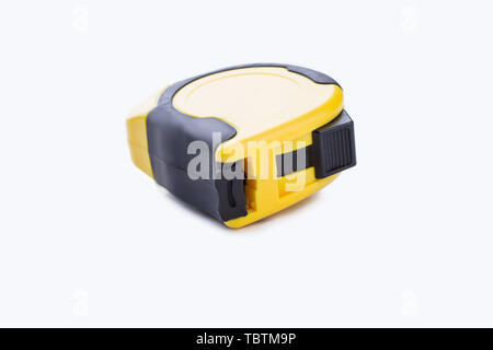 Builders tape measure isolated on white background. Measuring roulette, horizontal image. - Stock Photo