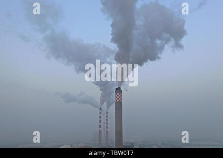 The flue gas being emitted from the chimney of a thermal power plant. - Stock Photo