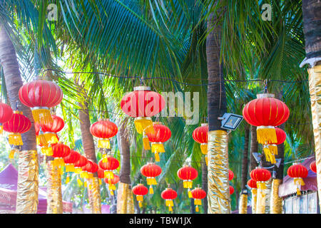 Red Chinese Paper Lanterns on the trees - Stock Photo