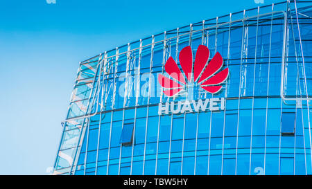 Vilnius, Lithuania - June 03, 2019: Huawei logo on modern building wall. Huawei is Chinese multinational technology company - Stock Photo