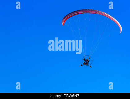 the sport paramotor and blue sky on Kamchatka, Russia - Stock Photo