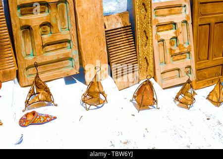 Flea market. Old things of Maracan life, old lamps, doors, a laundry board, shoes in the Medina of Rabat are sold on the street. Morocco - Stock Photo