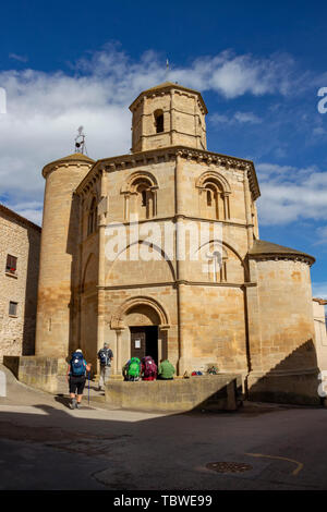Pilgrims in front of the Church of Santo Sepulcro, Church of the Holy Sepulchre in Torres del Rio, Navarre Spain on the Way of St. James, Camino de Sa - Stock Photo