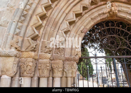 12th-century Romanesque doorway of the cemetery in Navarrete, La Rioja, Spain on the Way of St. James or Camino de Santiago, detail - Stock Photo