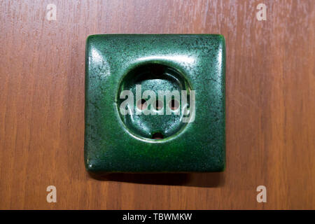 ceramic electric green socket made with a plaster mold. double firing, icing. Ceramist meeting and exchange of experience. reportage - Stock Photo