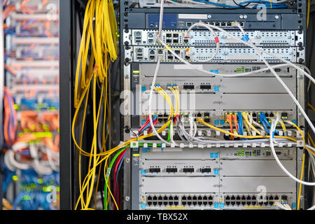 Close up of modern server room with many cables - Stock Photo
