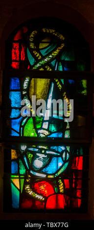 Detail of stained glass from Eglise Saint Vincent des Baux in Les Baux-de-Provence, France - Stock Photo