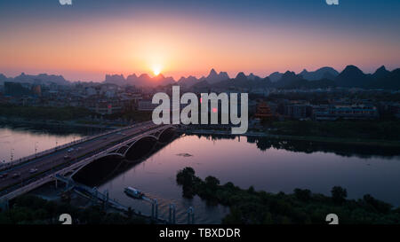 Guilin Jiefang Bridge Lijiang River, two rivers and four lakes sunset - Stock Photo