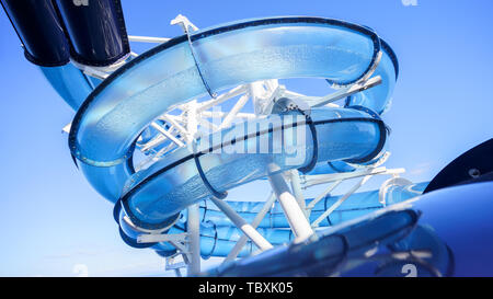 Water park slide pipe or float tube on the cruise liner ship in the open sea or ocean - Stock Photo