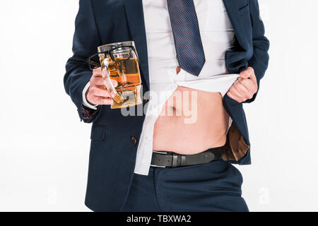 cropped view of overweight man in formal wear holding glass of beer and showing belly isolated on white - Stock Photo